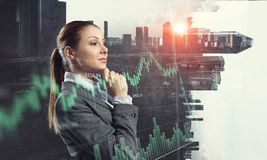 Businesswoman making desicion. Pensive businesswoman with hand on chin modern buildings and infographs Royalty Free Stock Photography