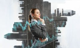 Businesswoman making desicion. Thoughtful businesswoman with hand on chin on modern city background Royalty Free Stock Photography