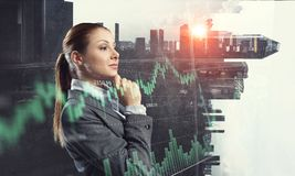 Businesswoman making desicion. Thoughtful businesswoman with hand on chin on modern city background Stock Photos
