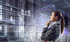 Businesswoman making desicion. Thoughtful businesswoman with hand on chin looking at media panel Stock Photography