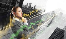 Businesswoman making desicion. Thoughtful businesswoman with hand on chin on modern city background Stock Photography