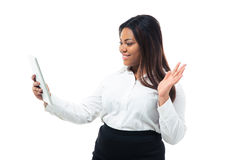Businesswoman making greeting gesture to tablet computer Royalty Free Stock Photos