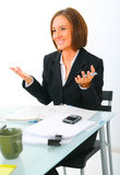 Businesswoman Making Hand Gesture While Talking Royalty Free Stock Image