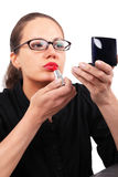 Businesswoman making make-up Stock Image