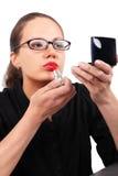 Businesswoman making make-up Stock Image