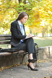 Businesswoman making note Stock Photo