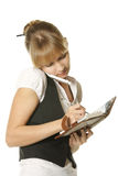 Businesswoman making notes Stock Photography