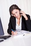 Businesswoman making notes Stock Photos