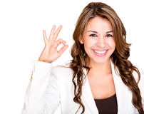 Businesswoman making an ok sign Royalty Free Stock Photos