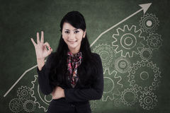 Businesswoman making an ok sign 2 Stock Photos