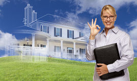 Businesswoman Making Okay Hand Sign with Ghosted House Drawing B Stock Photos