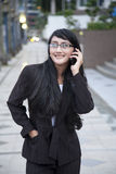 Businesswoman making a phone call. Outside the office Stock Photography