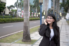 Businesswoman making a phone call. Outside the office Royalty Free Stock Images