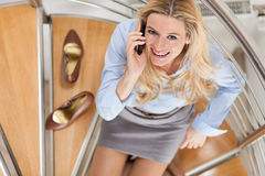 Businesswoman making a phone call at home Royalty Free Stock Photos