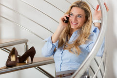 Businesswoman making a phone call at home Stock Photography