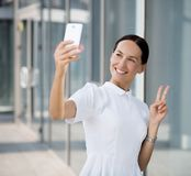 Businesswoman making selfies Stock Images