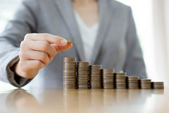 A Businesswoman Making Stack Of Coins Stock Image