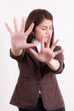 Businesswoman making stop gesture and showing stop Stock Image