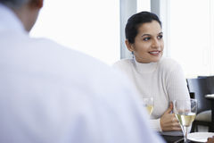 Businesswoman With Male Colleague In Restaurant Royalty Free Stock Image
