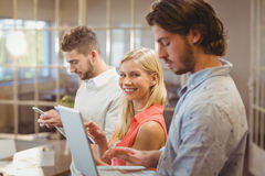 Businesswoman with male colleagues working in creative office Royalty Free Stock Photography