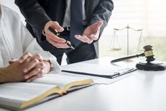 Businesswoman and Male lawyer or judge consult and conference having team meeting with client at law firm in office, Law and Legal royalty free stock image