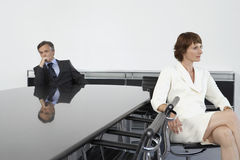 Businesswoman And Man At Conference Table Stock Images