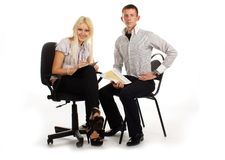 Businesswoman and man on office chair Royalty Free Stock Image