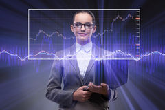 The businesswoman with many financial charts. Businesswoman with many financial charts Royalty Free Stock Photo