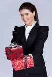 Businesswoman with many gift packages Stock Image