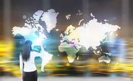 Businesswoman with map. Traveling concept with businesswoman and abstract map on blurry city background Stock Images