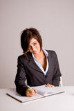 Businesswoman marking calendar Royalty Free Stock Image