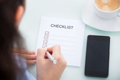 Businesswoman marking on checklist Royalty Free Stock Image