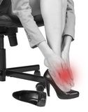 Businesswoman massaging her aching foot Stock Photo