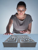 The businesswoman with maze in difficult situations concept Stock Photo