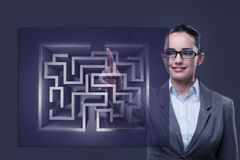 The businesswoman with maze in difficult situations concept Stock Image