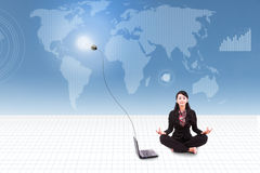 Businesswoman meditate with laptop on world map background Royalty Free Stock Photography