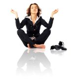 Businesswoman Meditating. Businesswoman with legs crossed meditating Stock Image