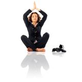 Businesswoman Meditating. Businesswoman with legs crossed meditating Royalty Free Stock Photo