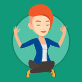 Businesswoman meditating in lotus position. Stock Photo