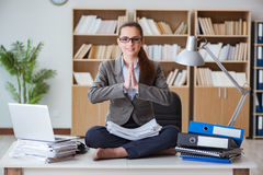 The businesswoman meditating in the office Stock Images