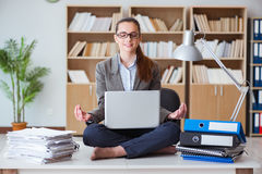 The businesswoman meditating in the office Royalty Free Stock Photography