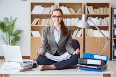 The businesswoman meditating in the office Stock Photo