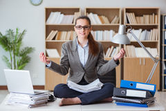 The businesswoman meditating in the office Royalty Free Stock Photo