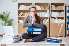 The businesswoman meditating in the office Royalty Free Stock Image