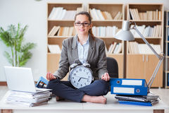 The businesswoman meditating in the office. Businesswoman meditating in the office Stock Images