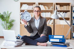 The businesswoman meditating in the office. Businesswoman meditating in the office Stock Photography