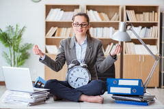 The businesswoman meditating in the office. Businesswoman meditating in the office Stock Image