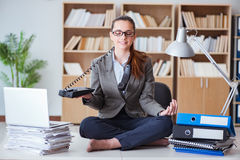 The businesswoman meditating in the office. Businesswoman meditating in the office Royalty Free Stock Photos