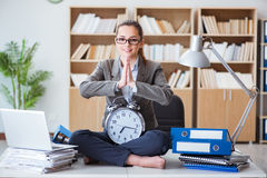 The businesswoman meditating in the office. Businesswoman meditating in the office Royalty Free Stock Images
