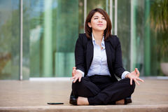 Businesswoman meditating outdoors Royalty Free Stock Photos